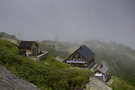 swiss alps: hut in swiss alps during summer