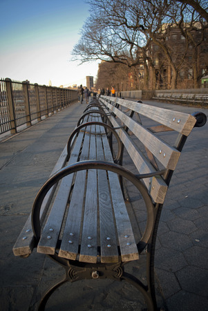 heights: bench on the brooklyn heights promenade at dusk