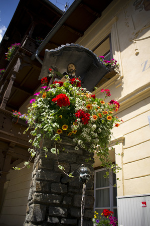 matrei: small fountain with flower in austria