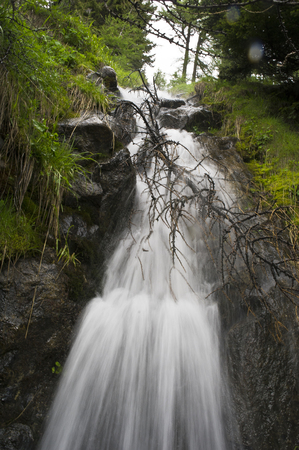 swiss alps: little waterfall in swiss alps