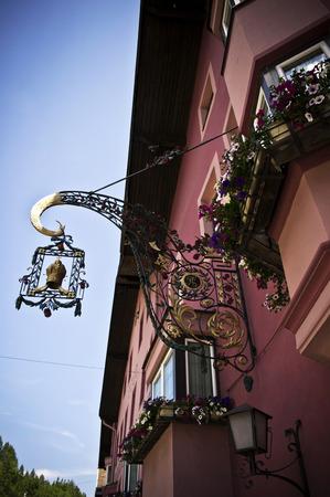 matrei: facade of a pink house in matrei am brenner