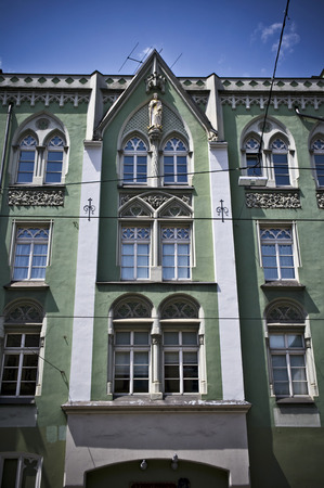 innsbruck: facade of a green palace in innsbruck