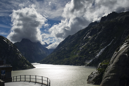 swiss alps: lake at grimsel pass in swiss alps
