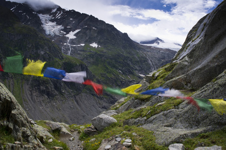 swiss alps: tibetan flags in the wind in swiss alps