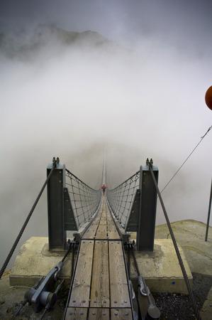 swiss alps: walking on suspended bridge in swiss alps Stock Photo