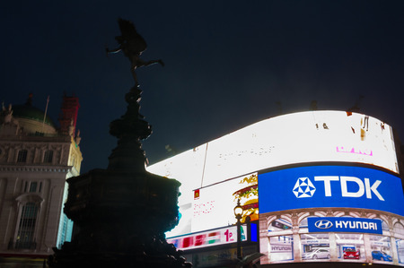 eros fountain in piccadilly circus by night Editorial