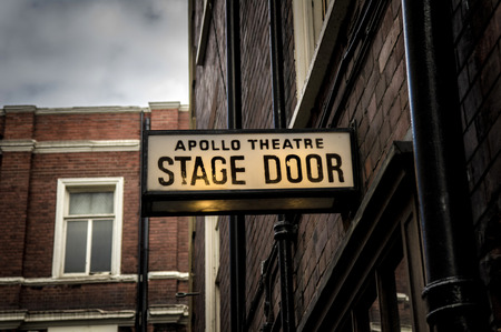 apollo theatre stage door signboard in london