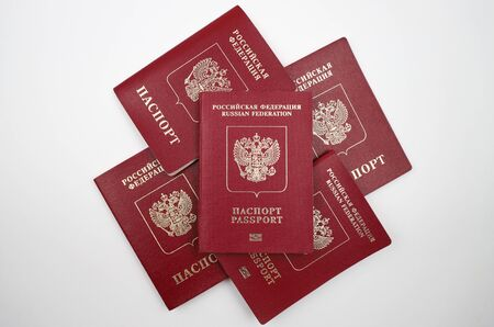Russian passport, five pieces, on a white background.