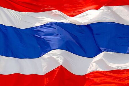 The flag of Thailand flutters in the wind. Фото со стока