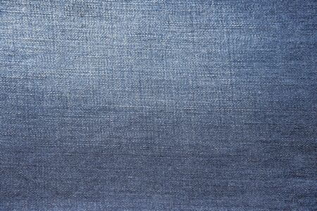 Denim texture of blue fabric. Stock Photo
