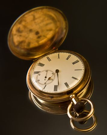 gold pocket watch photo
