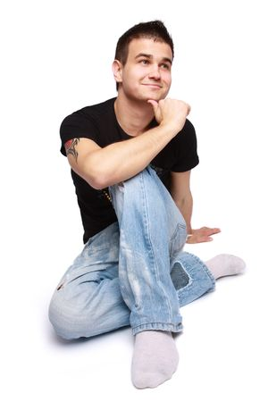 Portrait of a handsome young man sitting on the floor photo