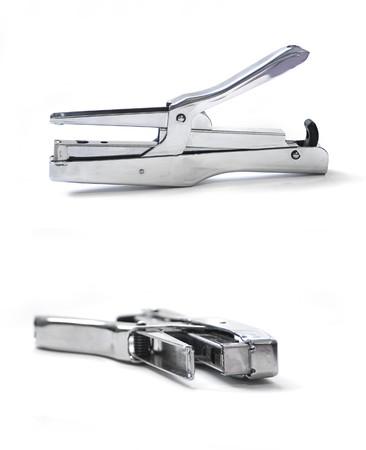 two metallic staplers isolated on white photo
