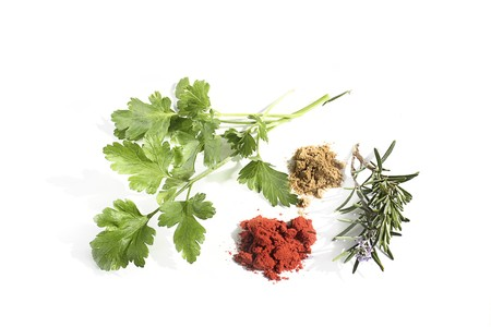 Parsley, rosemary and spices isolated on white Stock Photo - 7845924