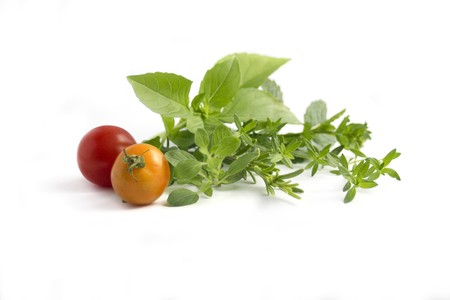various herbs and cherry tomatoes isolated on white Stock Photo - 7845933