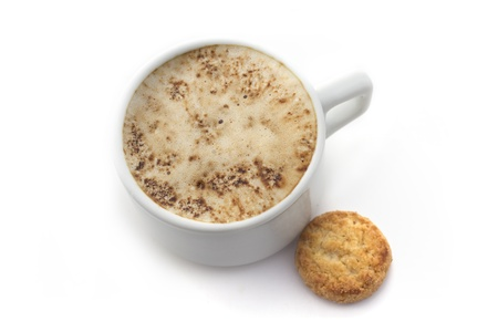 White Cup of coffee with small cookie  isolated on white background photo