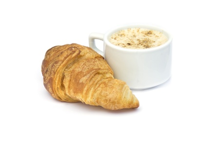 Breakfast concept:  Cappuccino  and croissant isolated on white photo