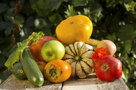 Autumn vegetable and fruits on old wood photo