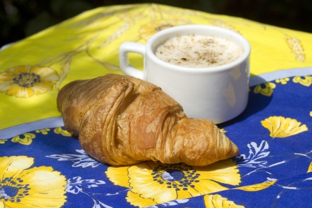 traditionally french: Croissants isolated on colored  Tablecloth Stock Photo
