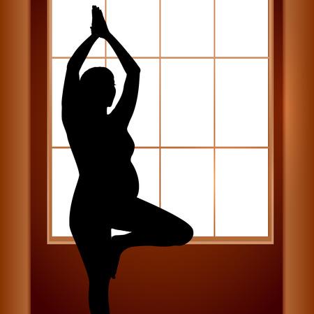 pregnancy yoga: Pregnant woman in yoga position near window