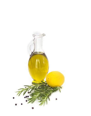 Lemon rosemary and olive oil on white background