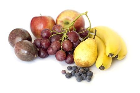 midsagittal: Stack of Fresh Fruits isolates on white backgrtound