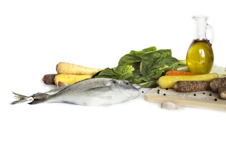 wine stocks: Delicious fresh fishisolated on white  background. Fish with  spices and vegetables - healthy food, diet or cooking concept