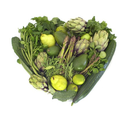 Big heart made of green veggies isolated on white