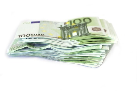 Stack of euros hundred and two hundreds bills isolated on gray
