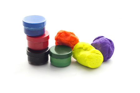 clay modeling: Three Modelling clay balls and filger painting of different colors isolated on a white background
