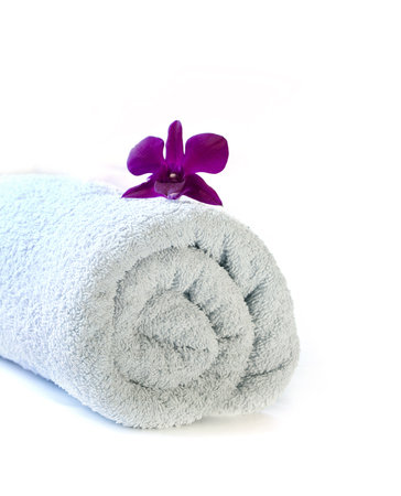 folded: Bath towel with flower on white background
