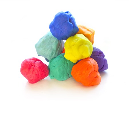 modelling: Three Modelling clay balls of different colors isolated on a white background