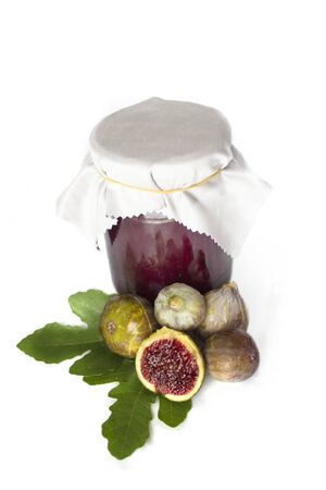Fig jam with figs and leaves on white Banco de Imagens