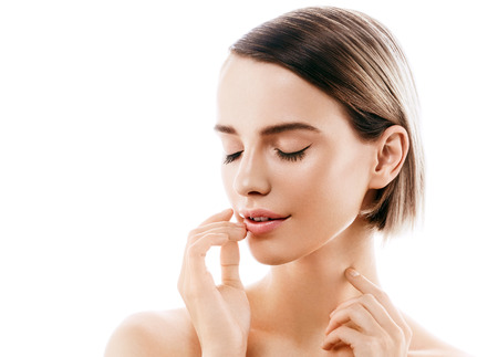 Beauty Woman face Portrait. Beautiful model Girl with Perfect Fresh Clean Skin color lips purple red. Blonde brunette short hair Youth and Skin Care Concept. Isolated on a white background 스톡 콘텐츠