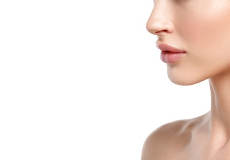 Beauty Woman lips, nose, shoulders Portrait. Beautiful model Girl with Perfect Fresh Clean Skin. Youth and Skin Care Concept. Isolated on a white background Foto de archivo