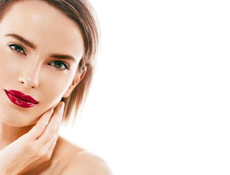 Beauty Woman face Portrait. Beautiful model Girl with Perfect Fresh Clean Skin color lips purple red. Blonde brunette short hair Youth and Skin Care Concept. Isolated on a white background 版權商用圖片