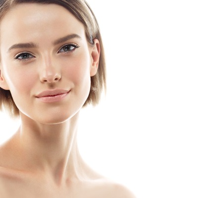 Beauty Woman face Portrait. Beautiful model Girl with Perfect Fresh Clean Skin color lips purple red. Blonde brunette short hair Youth and Skin Care Concept. Isolated on a white background Foto de archivo