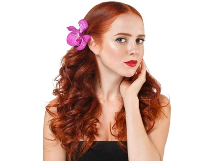 beige lips: Beautiful woman portrait with flower in hair perfect make up manicure pink lips and nails on beige background isolated Stock Photo