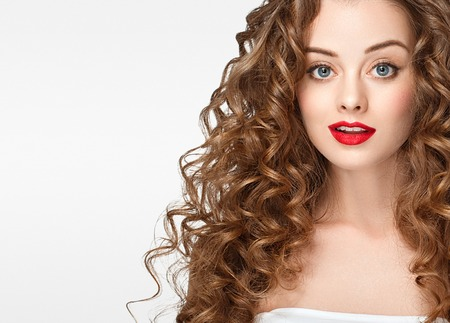 Curly hair woman portrait long hair with perfect make up red lips isolated on white Reklamní fotografie