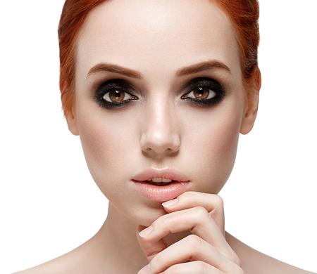 smoky black: Beautiful woman face close up. Smoky black make up on eyes. Beautiful portrait isolated on white