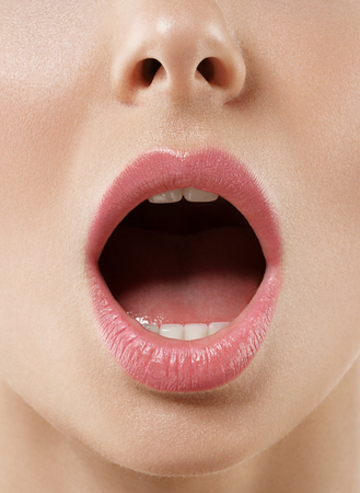Open mouth woman close up. Studio shot. Banco de Imagens - 63608568