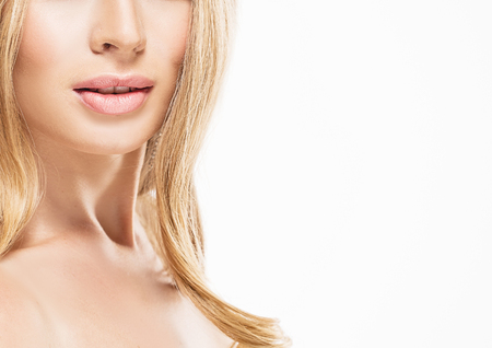 collarbone: Woman neck shoulder lips nose. Studio shot. Isolated on white.