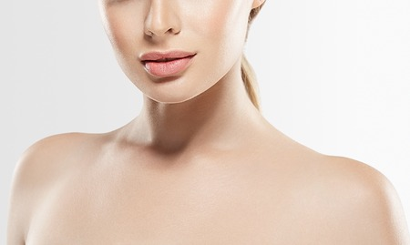 long nose: Woman neck shoulder lips nose. Studio shot. Isolated on white.