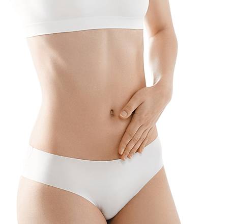 slim women: health and beauty concept - beautiful woman in white cotton stomach with hand. Studio shot. Stock Photo