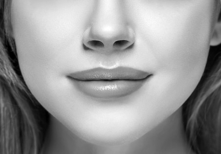 Lips and nose Woman happy young beautiful studio portrait. Black and white. Stock Photo