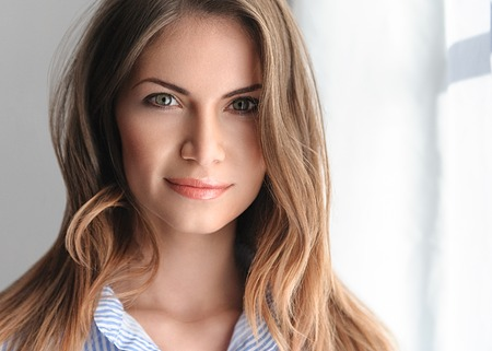 light hair: Young beautifull woman in blue shirt with sexy pink lips. Studio shot.