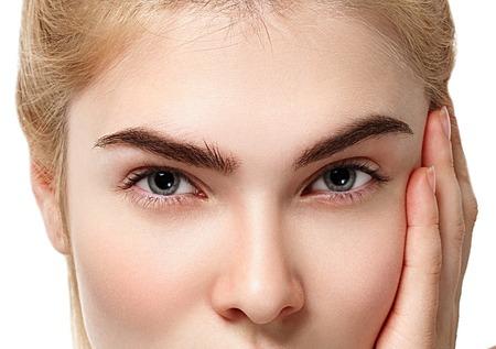 Eyes. Closeup shot of blonde woman eye with day makeup. Studio shot.