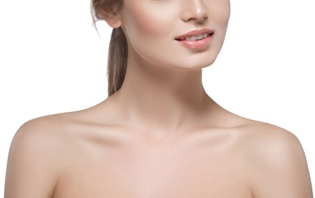 Shoulders neck lips Beautiful woman face close up portrait young. Isolated on white. Studio shot. 스톡 콘텐츠