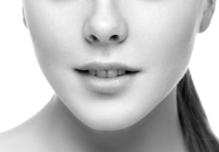 Lips nose neck Woman face young beautiful healthy skin portrait. Black and white. Studip shot.