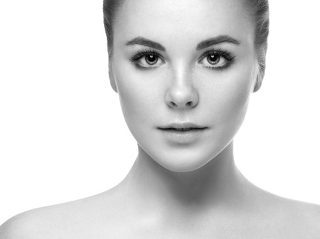 Beautiful woman portrait face. Isolated on white. Black and white. Studio shot. Imagens